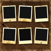 Old photoframes are hanging — Stockfoto
