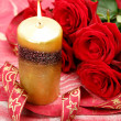 Roses and a candle — Stock Photo #1442827
