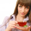 The girl with a cup of tea — Stock Photo