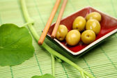 Olives and wooden sticks — Stock Photo