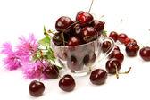Ripe cherry in a mug — Stock Photo