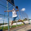 Stock Photo: Basketball player is aiming the basket