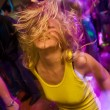 Young blond girl on the dancefloor — Stock Photo