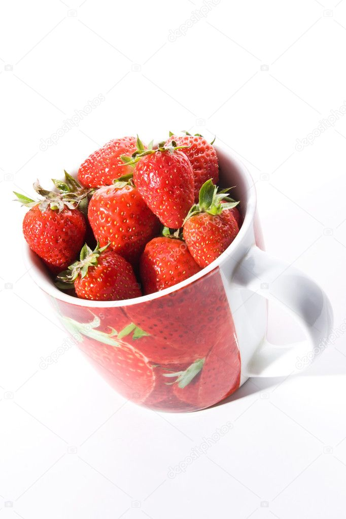 Red cup filled with fresh ripe strawberries  Stock Photo #1162512
