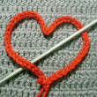 Red knitted heart — Stock Photo