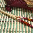 Japanese fan and chopsticks - Stock Photo