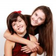 Two smiling sisters, on white — Stock Photo