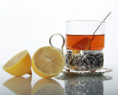 Tea in glass mug and lemons — Stock Photo