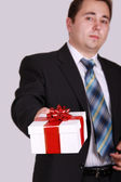 Portrait men with gift — Stock Photo