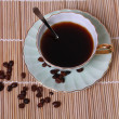 Cup coffee and coffee beans - Stock Photo