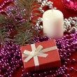 Cristmas gift, candles and glassbeads — Stock Photo