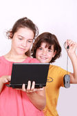 Two attractive sisters with computer — Stock Photo