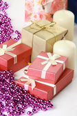 Cristmas gift, glassbeads and candle — Stock Photo