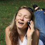 Girl talks on mobile telephone — Stock Photo
