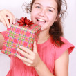 Daring girl opens gift - Stock Photo