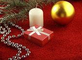 Christmas gift, glassbeads and gold ball — Stock Photo