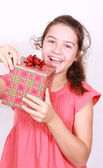 Daring girl opens gift — Stock Photo