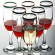 Wine goblets on mirror table — Stock Photo