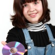 Beautiful girl holding a CD — Stock Photo