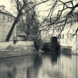 Water mill in Prague retro photo - Stok fotoğraf