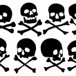Stock Vector: Set of pirate skulls and crossbones