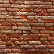 Old cracked red bricks texture — Stok fotoğraf