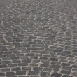 Old medieval granite cobble road — Stok fotoğraf
