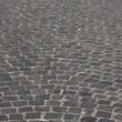Old medieval granite cobble road — Stock Photo #1219464