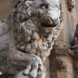 Old lion sculpture - Stock Photo