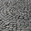 Old medieval granite cobble road — Stock Photo