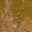 Cracked paint on wooden background - Stockfoto