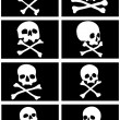 Pirate flags with skulls and crossbones — Stock Vector