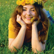 Girl in wreatht from dandelions — Stock Photo #1165296