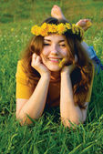 Girl in a wreatht from dandelions — Stock Photo