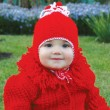 Stock Photo: Little girl in red clothes
