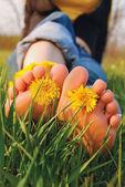 Feet on the grass — Stock Photo