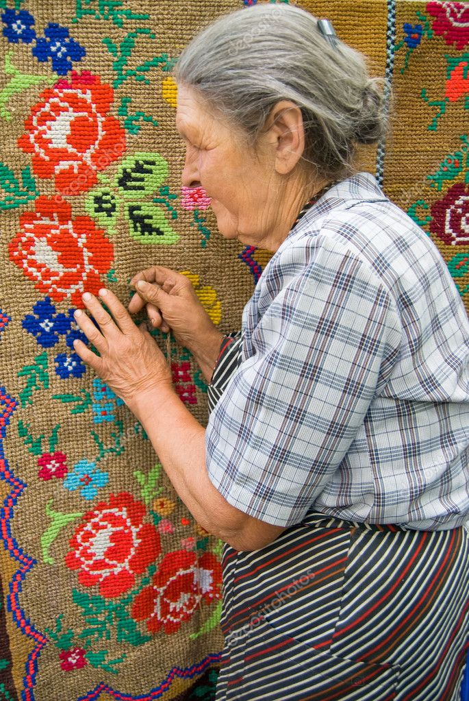 Old woman with her needlework — Stock Photo #1522135