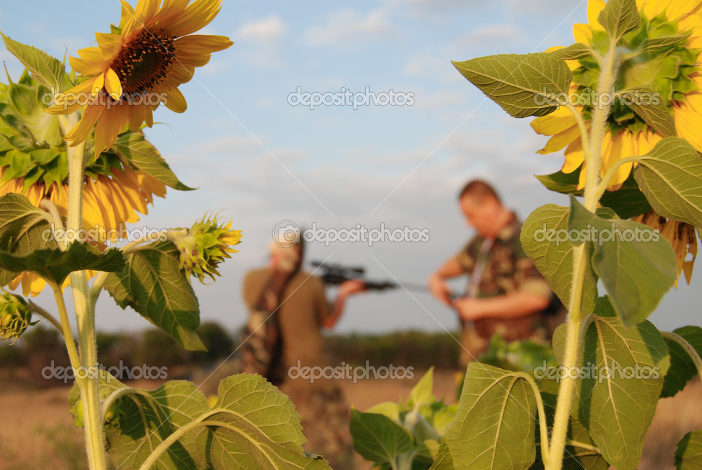 Hunters in camouflage with rifle at ready — Stock Photo #1522930