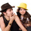 Young couple enjoying music by harmonica on isolated studio picture — Stock Photo #1972392