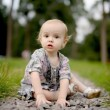 Little upset baby on the park alley — Stock Photo #1799211