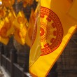 Royalty-Free Stock Photo: Yellow flags near Asian Wat