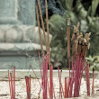 Burning incense in urn at buddhist pagod - Stock Photo