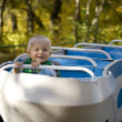Little boy on the merry-go-round — Stockfoto