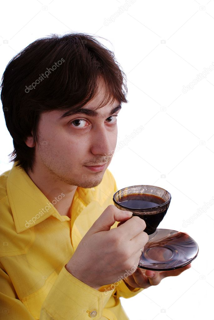 Young man with a cup of coffee  Stock Photo #1425290