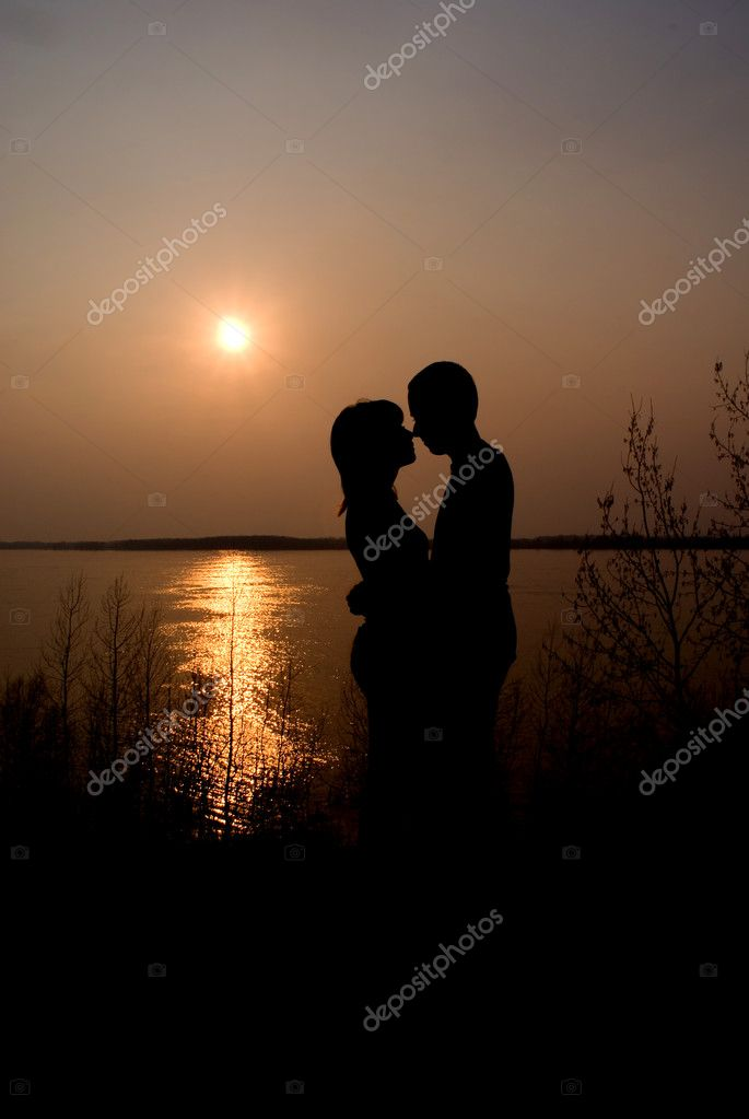 Couple over sunset background — Stock Photo #1426463