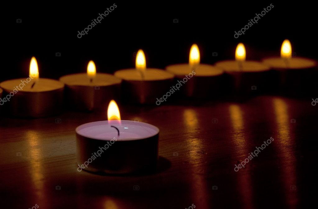 Many little flaming candles in the darkness background  Stock Photo #1546377