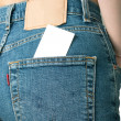 Blank business card in jeans pocket — Stock Photo