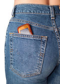 Phone in jeans pocket — Stock Photo