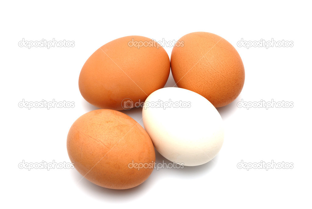 Four chicken eggs on a white background largly — Stock Photo #1215273