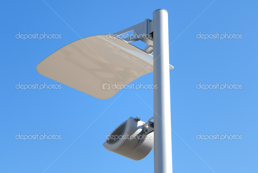 Modern lantern of street illumination against the blue sky  Stock Photo #1220759